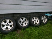 four gray 5-spoke car wheels with tires Rochester, 14606