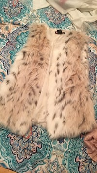white and brow faux fur vest