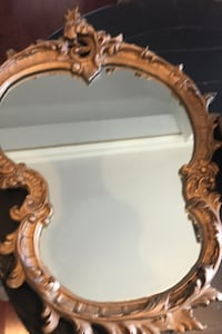 Antique ornate mirror. 28 by 24