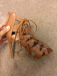 pair of brown leather open-toe gladiator sandals Burnaby, V5H 3N7