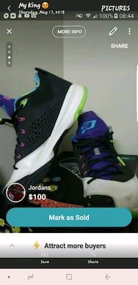 pair of black-and-green Nike basketball shoes Clarksville, 37042