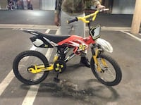 red, white, and black motocross bicycle