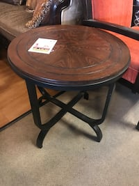 Round Wood End Table With A Metal Frame