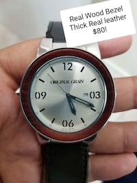 round silver-colored analog watch with black leather strap Brampton, L6R 1K5
