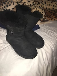 Pair of black sheepskin boots, size 7.  2238 mi