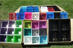 8 BOXES AVAILABLE BRAND NEW STACKABLE MULTI COLOR CD CRATES SELLING CHEAP $20.00 A CASE OF 18'S!!