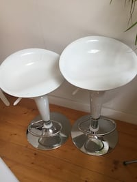 Two white bar stools