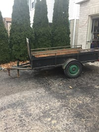 black and brown utility trailer 546 km