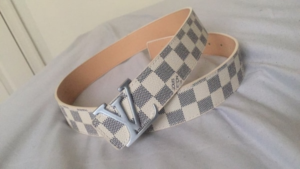 white and black Louis Vuitton leather belt