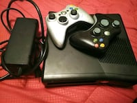 black Xbox 360 console with two controllers New Iberia, 70563