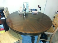 Bar height brown wooden round table and 3 chairs North Bay, P1B 6L6