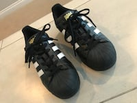 Pair of black adidas superstar shoes Grand Junction, 81504