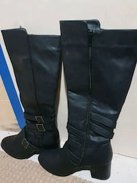 pair of black leather knee high boots Brampton, L7A 2M4
