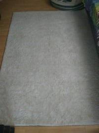Nice white soft  5 x 4 inch area rug from At Home Store