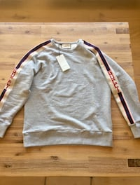 gray and red long-sleeved shirt 725 km