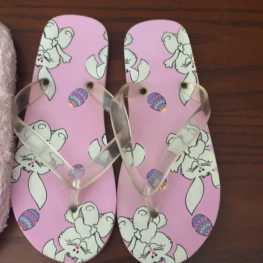 Pair of pink-and-white flipflops and pair of pink house slippers 7ac99de0-b01e-461d-9232-97c35be8c06b