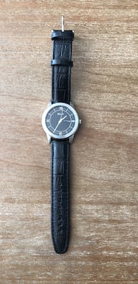 round silver analog watch with black leather strap Chicago, 60610