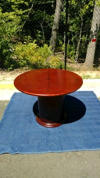 round brown wooden pedestal table Prince William County