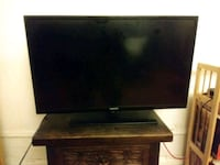 black flat screen TV with remote Brooklyn, 11212
