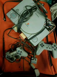 white Sony PS1 console with controller Laval, H7S 2N5