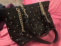 Black and gold purse. Inside is black too! Germantown, 20874