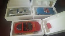 three blue, gray, and red diecast cars