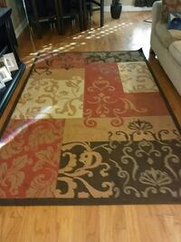 black, brown and red area rug New Orleans, 70128