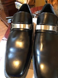pair of black leather slip-on shoes Simpsonville, 29680