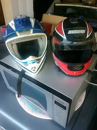 two red and blue full-face helmets 2337 mi