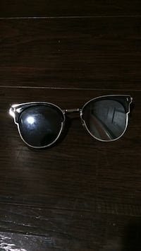 black framed Ray-Ban sunglasses 46 km