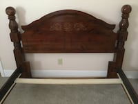brown wooden bed frame with white mattress Ithaca, 14850