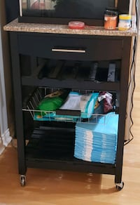 black wooden TV stand with flat screen television Surrey, V3S 2M9