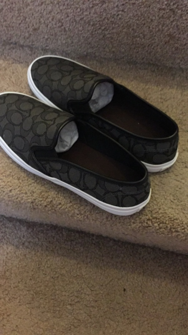 8cfdc8821a pair of black Coach slip-on shoes