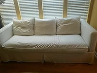 white fabric sofa Alexandria