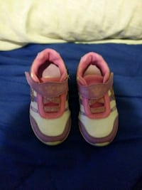 pair of pink-and-white Nike sneakers