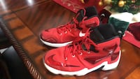 Pair of red nike basketball shoes Lakeshore, N0R