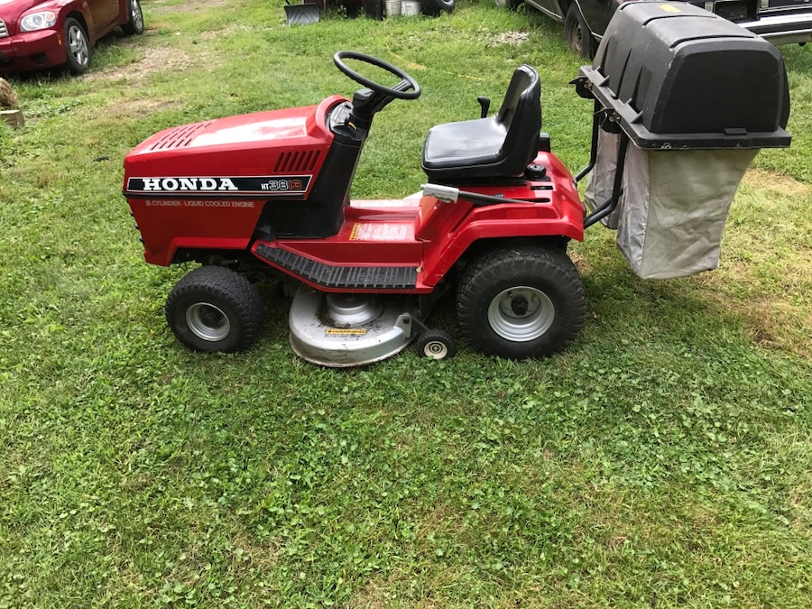Red And Black Honda Riding Mower