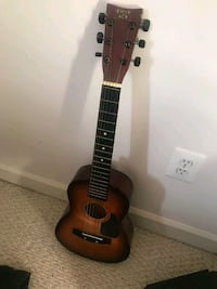 brown and black dreadnought acoustic guitar Fort Washington, 20744
