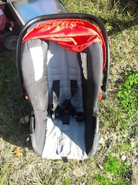 gray and white car seat carrier