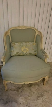 Mint green and cream wooden armchair