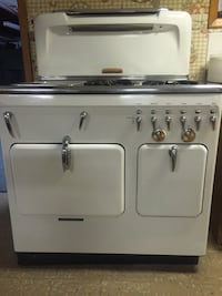 Silver and white gas range (chambers)