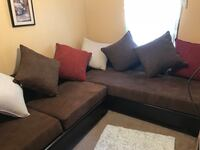 Black and gray sectional couch El Paso, 79936