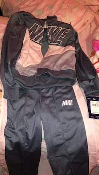 Black and gray nike zip-up jacket Jacksonville, 28546