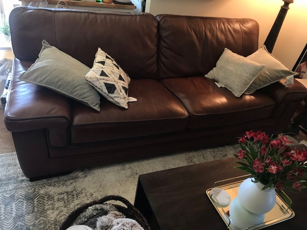 Cognac leather couch, brand new less than 1 year old