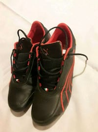 pair of black-and-red Adidas cleats Los Angeles, 91402