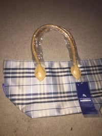 Brand new Burberry purse with tags
