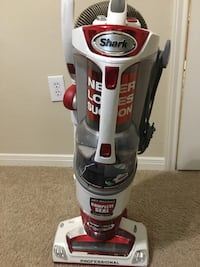 White and red shark upright vacuum cleaner