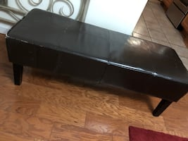 Brown leather ottoman bench