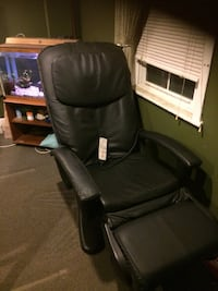 Black leather Massage Chair. Human Touch