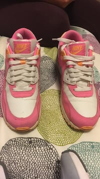 pair of pink-and-white Nike low-top sneakers